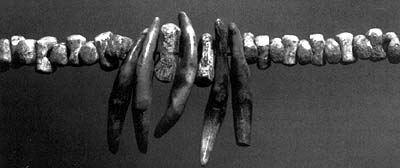 деньги - бусины из мамонтовой кости
